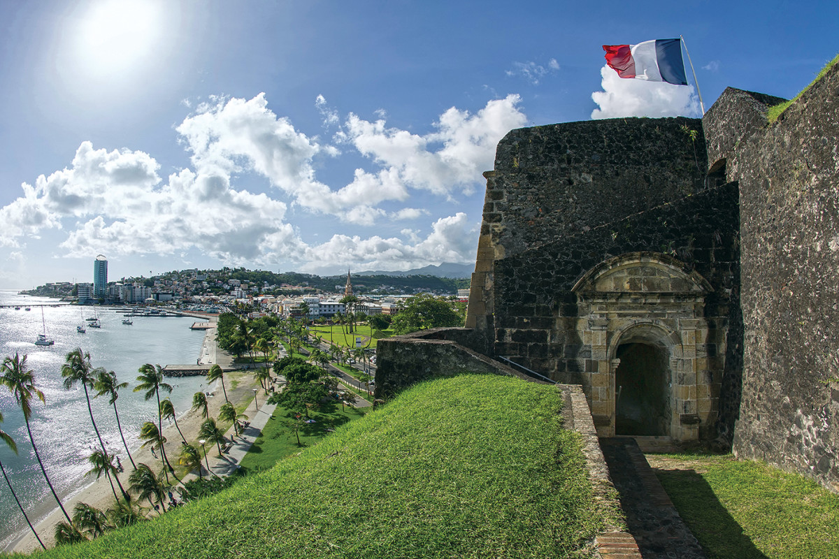 the tricolor flies above Fort Louis, guarding the island's capital, Fort de France