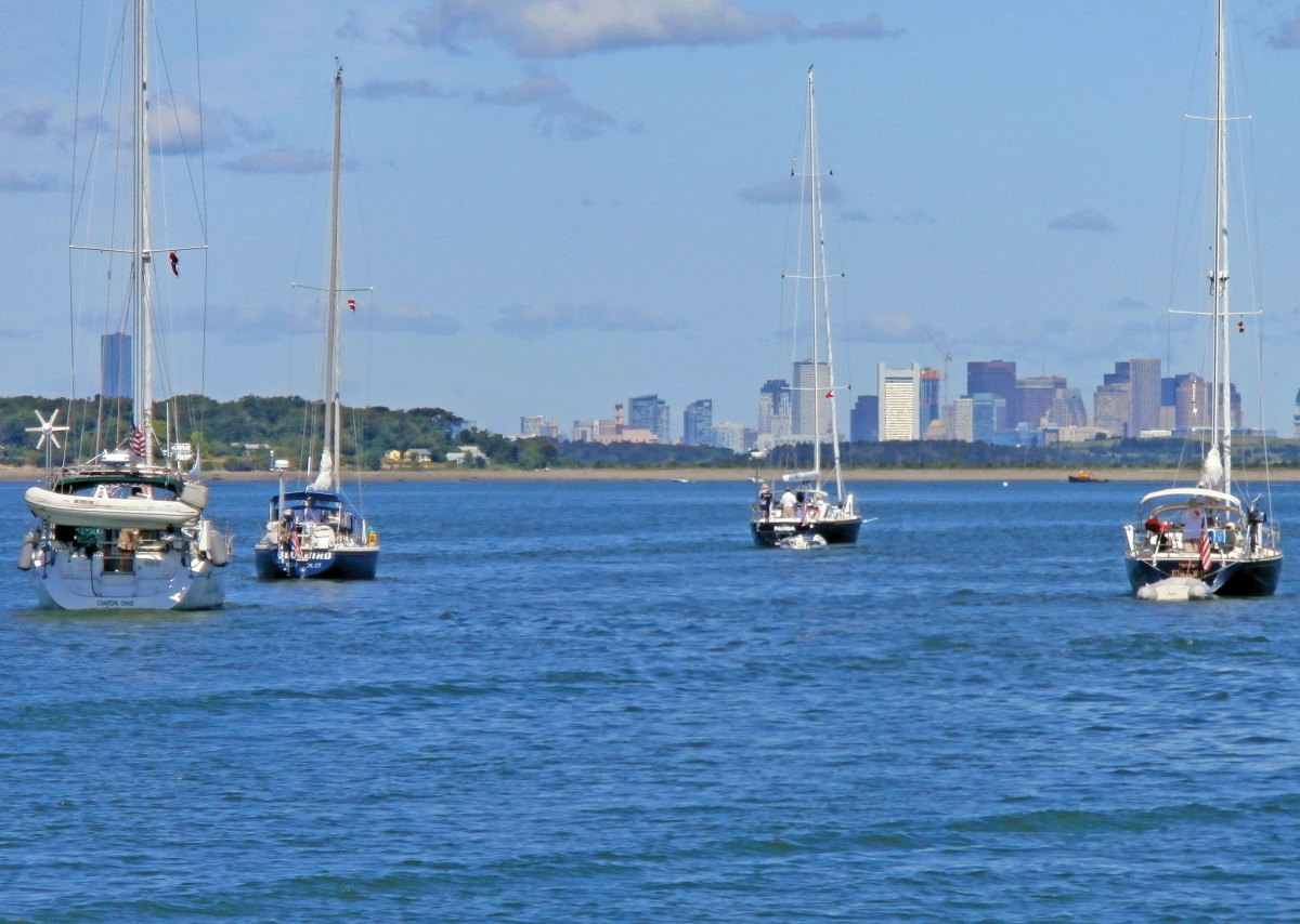 This photo shows some of the 20-plus boats on our club's annual cruise in 2015, heading towards Boston, Massachusetts from World's End island..—Susan Theuns