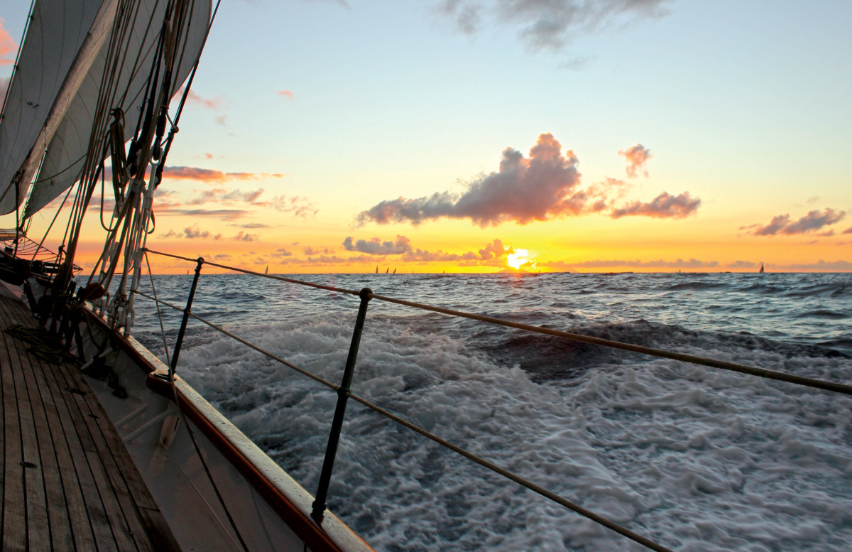 Plenty of breeze and sea room make for ideal schooner-sailing conditions as the sun goes down at the close of the first day of the race