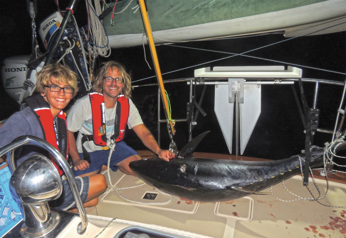 """""""The monster,"""" a 210lb yellowfin tuna, aboard the boat, finally"""