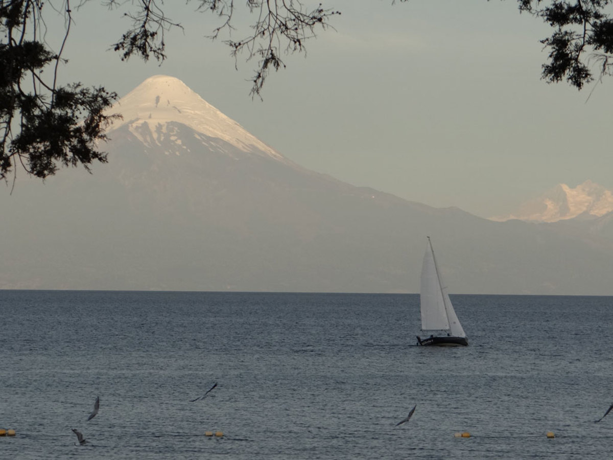 I took this picture on a trip to Chile this year. My wife and I were staying in Frutillar, on the western shore of Lago Llanquihue. Orsono volcano made the perfect backdrop for this lucky sailor. When we're not traveling we keep our boat on the Eastern Shore of Maryland. —Tom Lawler