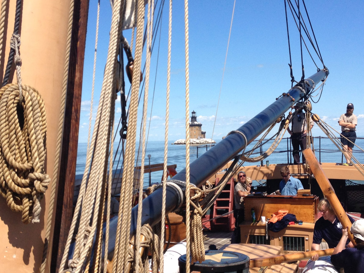 Last August, I sailed on a full-scale replica of the USS Niagara from Monroe, Michigan, to The National Museum of the Great Lakes in Toledo, Ohio. The brig Niagara was used by Commodore Perry during the War of 1812 to defeat the British fleet in the islands of western Lake Erie. This picture shows Toledo Harbor Light off the stern as we sailed up the channel. —Paul Smith