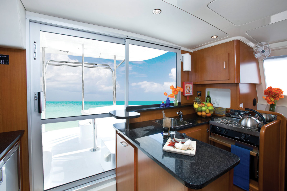 A spacious saloon galley on a cruising cat. Photo courtesy of Sunsail