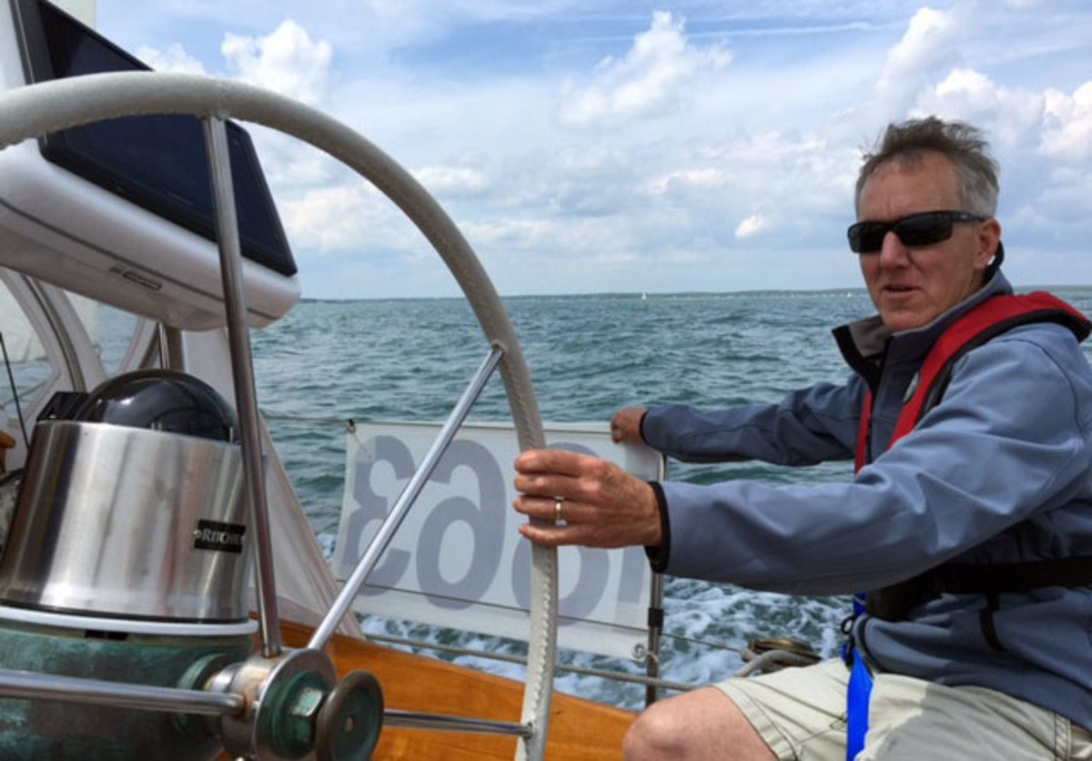 Author at the helm as the fleet leaves Buzzard's Bay