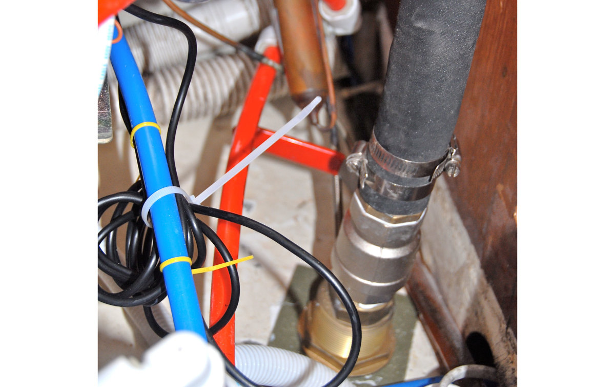 12. After running the new galley drain hose to the seacock, I started tidying up the assorted wiring and plumbing