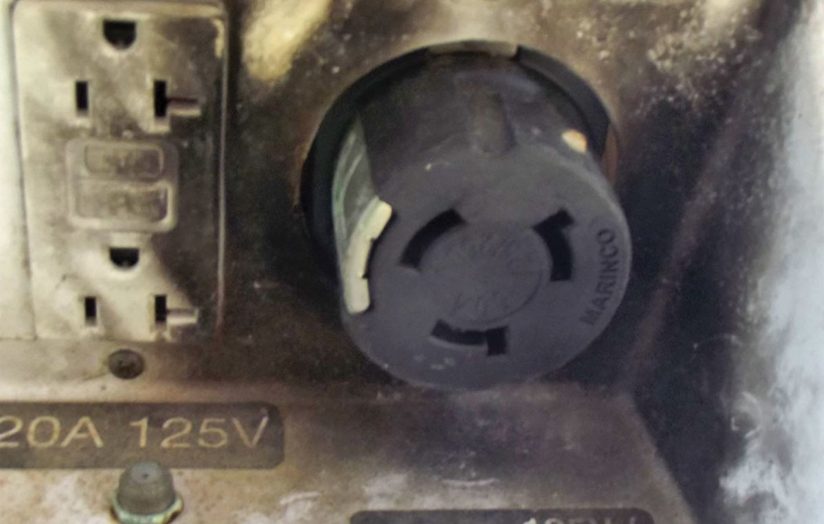 Photo 1. This power receptacle is obviously heat-damaged