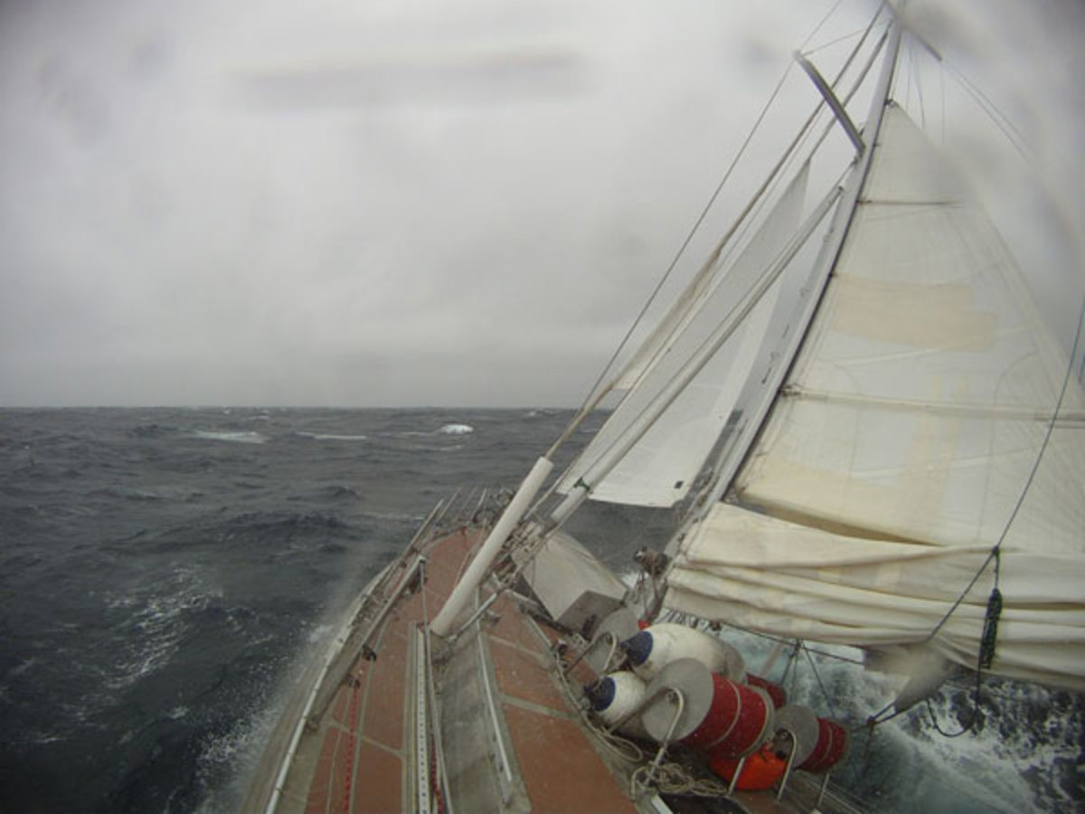 The cutter Seal beats to windward under her heavy weather rig of storm jib and triple-reefed main