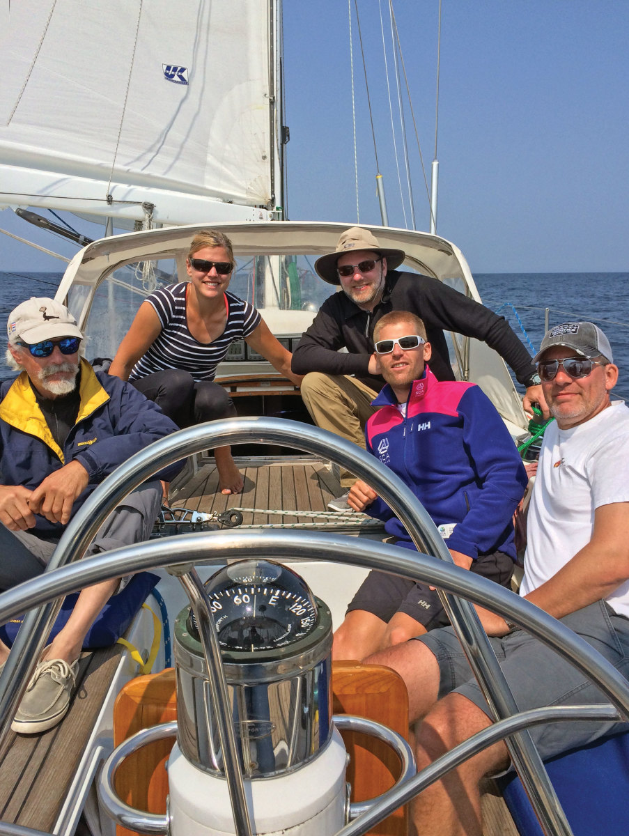 Isbjörn's crew relaxes midway between Annapolis and Lunenburg Nova Scotia. Photo by John Maxwell