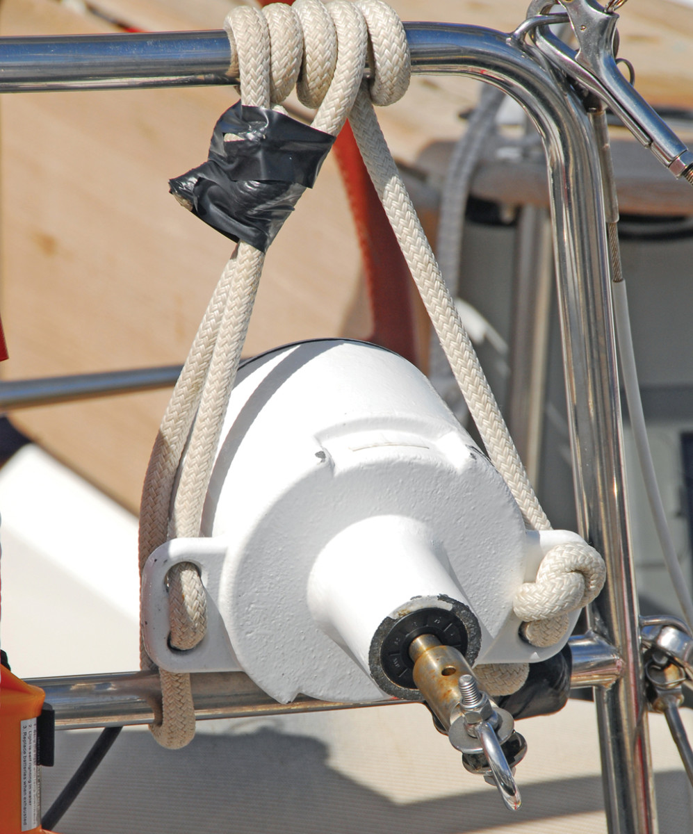 A transom-mounted water turbine drags a spinning propeller behind the boat to generator power