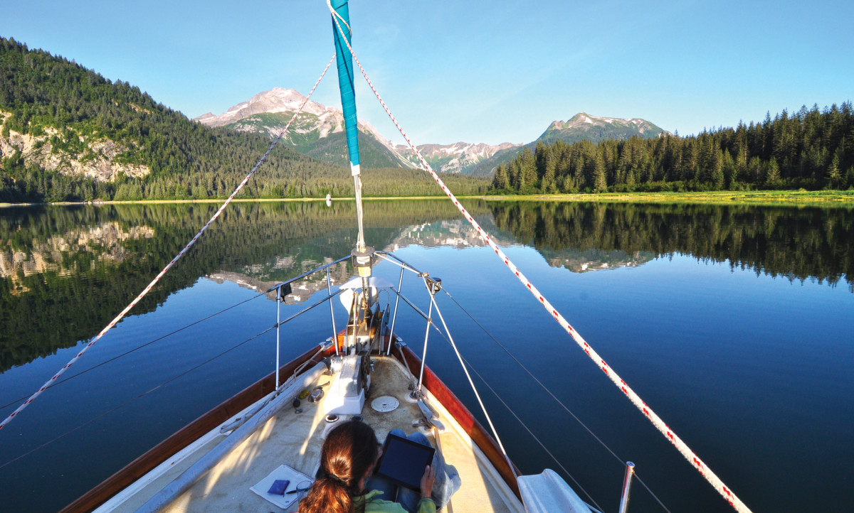 Del Viento anchored in absolute stillness among Glacier Bay's Beardslee Islands