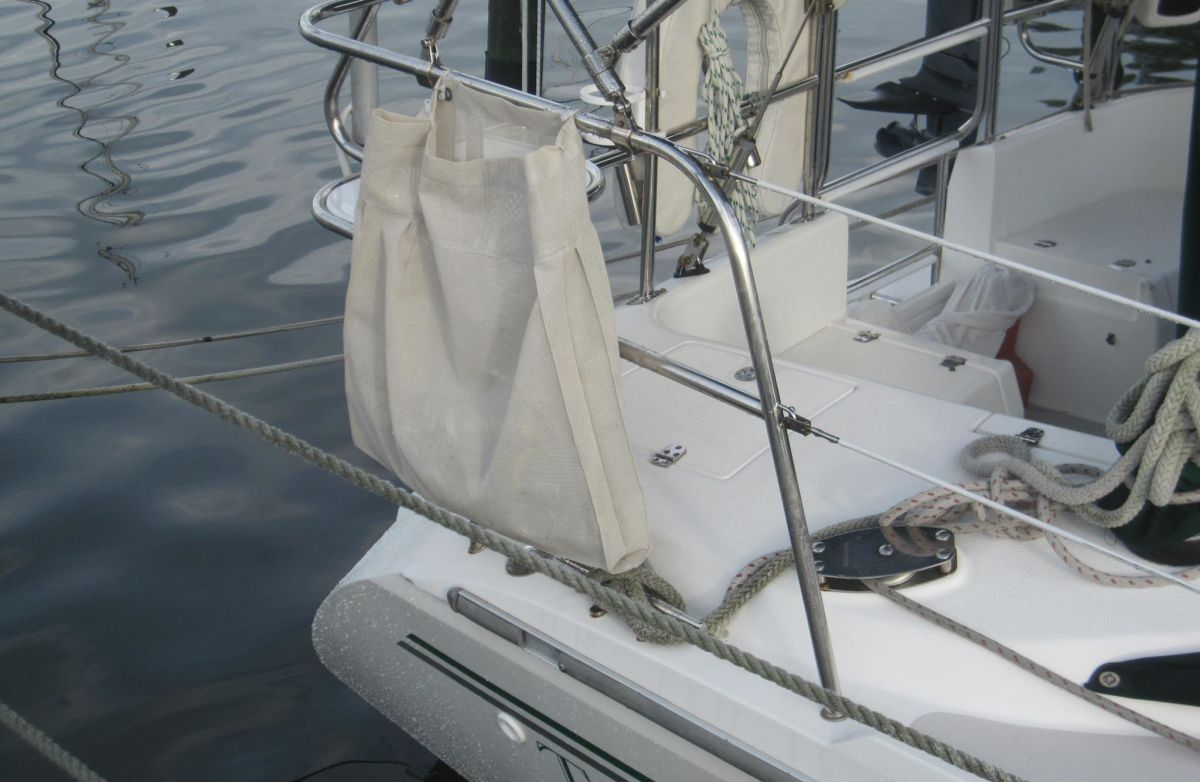 The recycling bag, positioned outboard, is a good place to stow unwanted trash until your next port of call