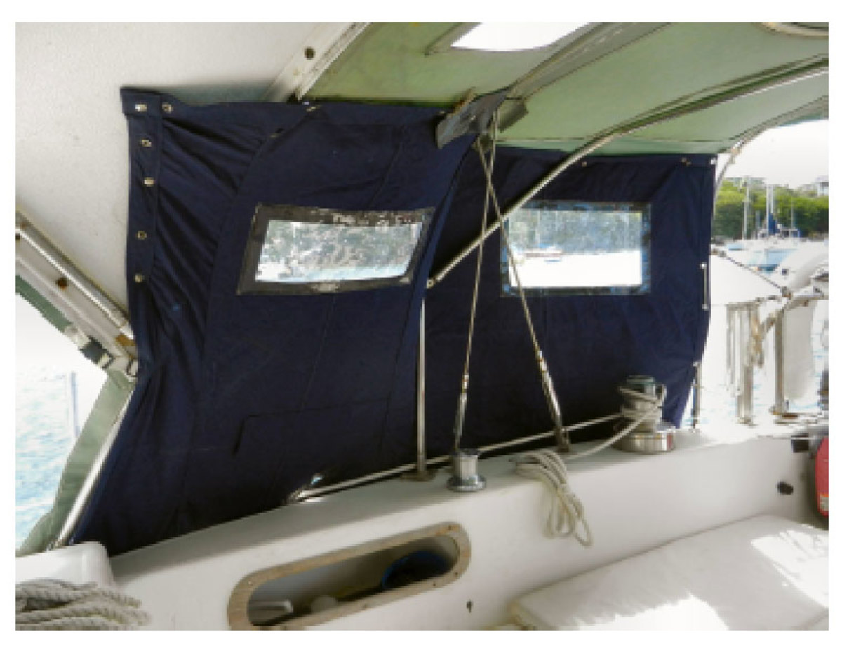 A simple fabric curtain that you can switch from one side of the cockpit to the other will help keep you dry when the spray is flying