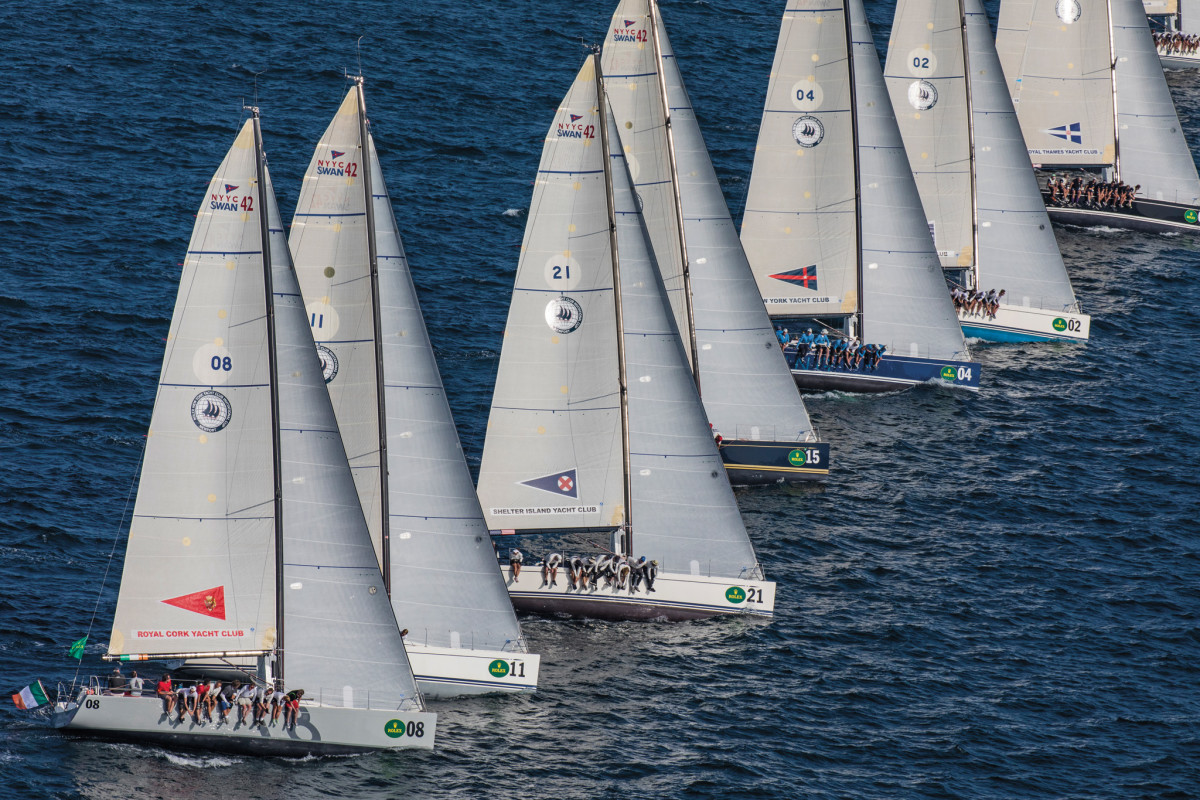 Burgees from clubs around the world are prominently displayed on each boat's mainsail