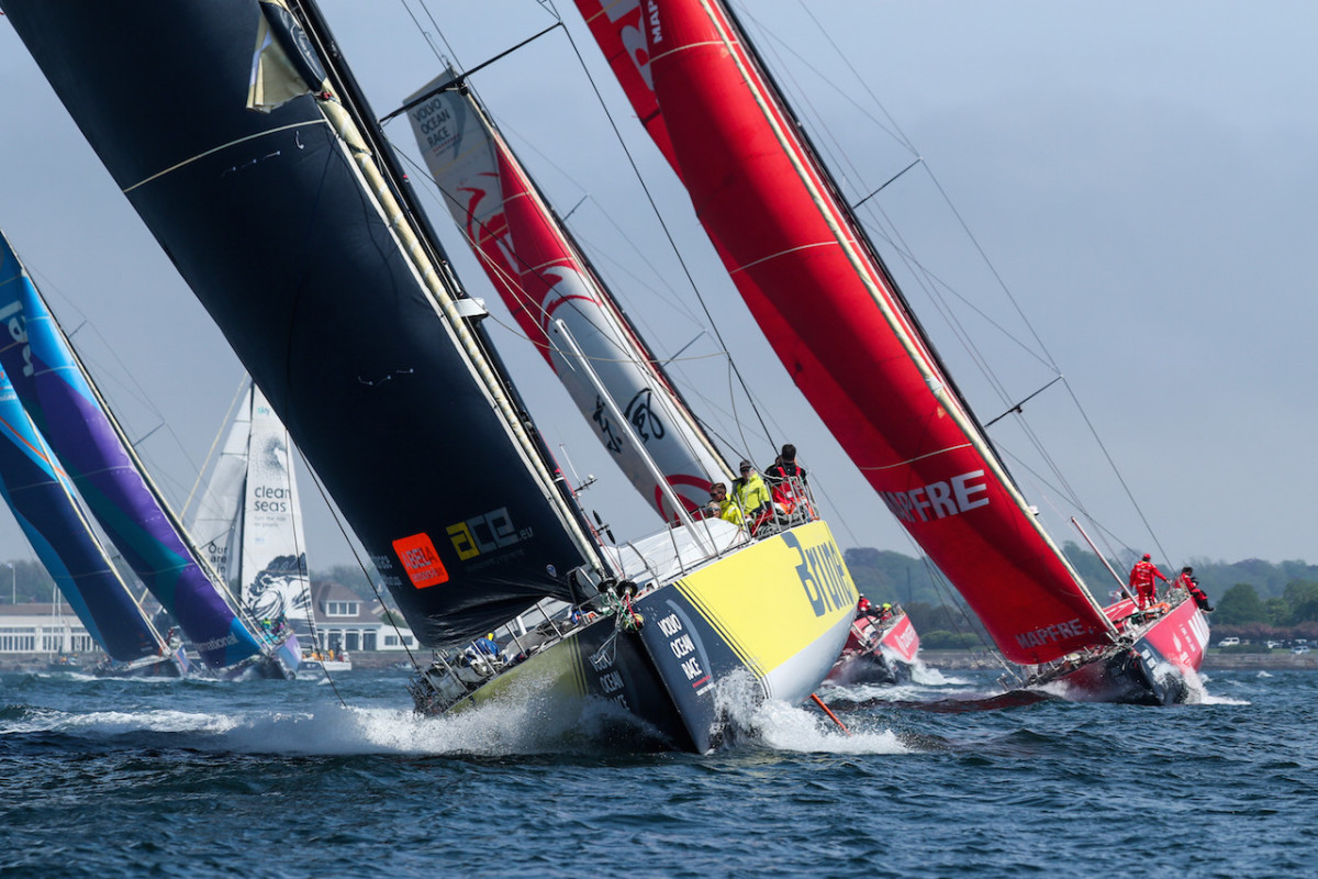 Team Brunel, in third place overall, leads the way out of Newport at the start of the leg
