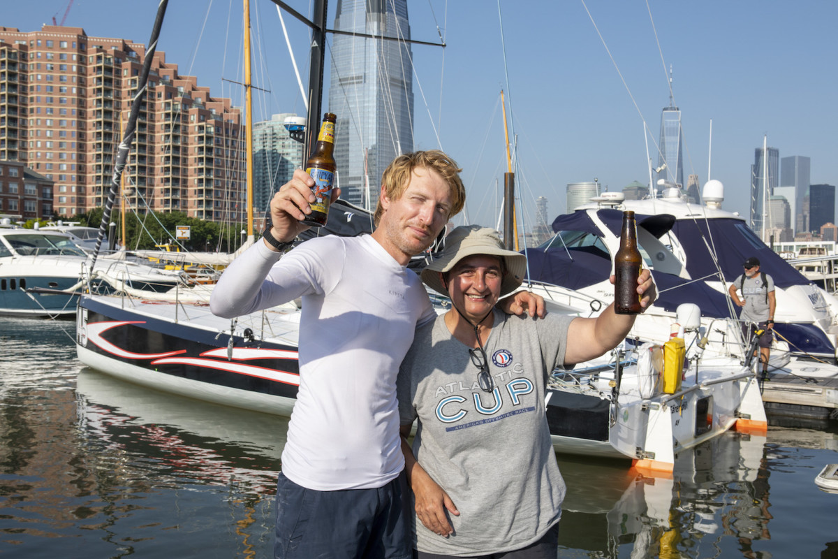 Luciani (left) and Pourre celebrate their win on the dock at Liberty Landing Marina
