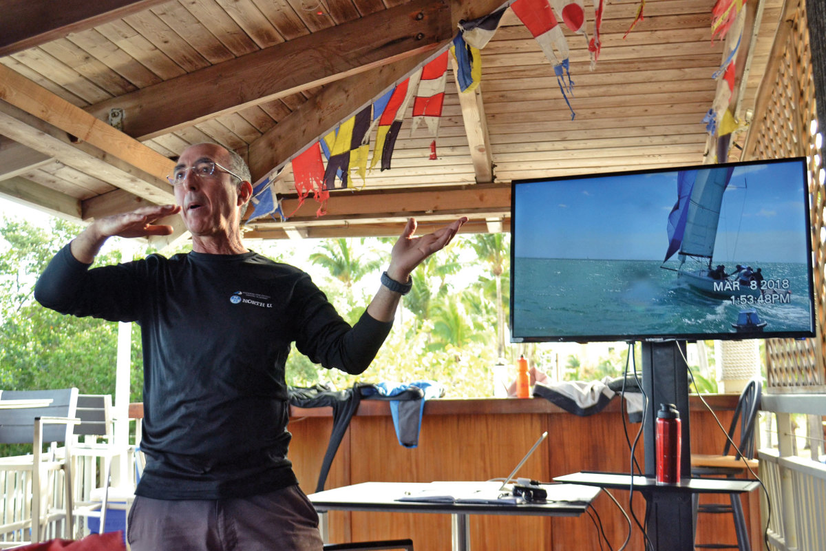 Bill Gladstone discusses boat handling while reviewing footage of the day's racing