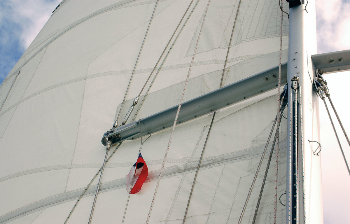 It's readily apparent how the spreader can chafe the sail in this photo: note the reinforcing patch