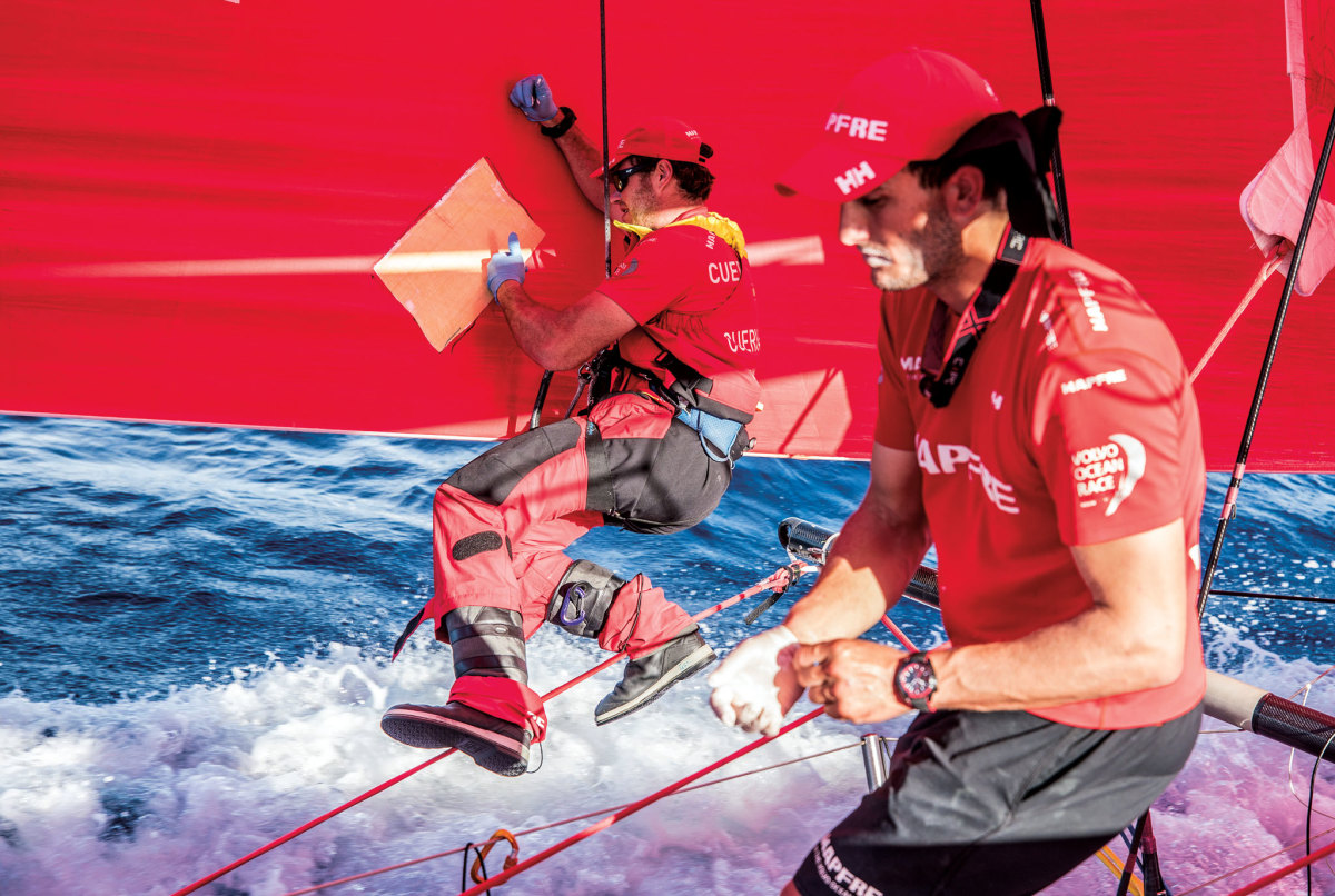 The crew of the Volvo Ocean 65 Mapfre takes care of a bit of chafe while underway