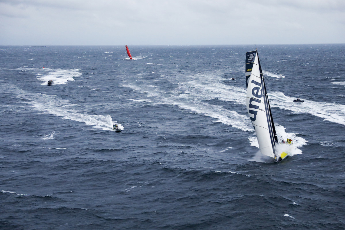 Team Brunel leads Mapfre toward the finish at the very end of Leg 10
