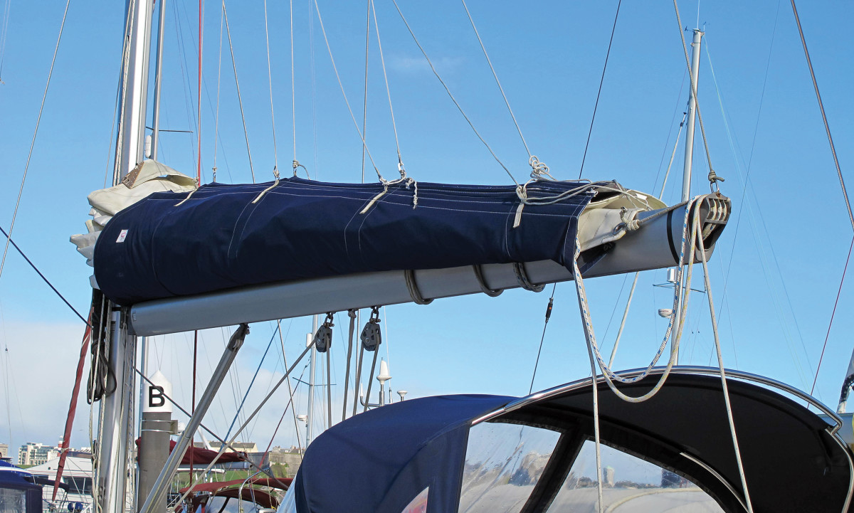 Save yourself some bother and don't pull the reefing lines through