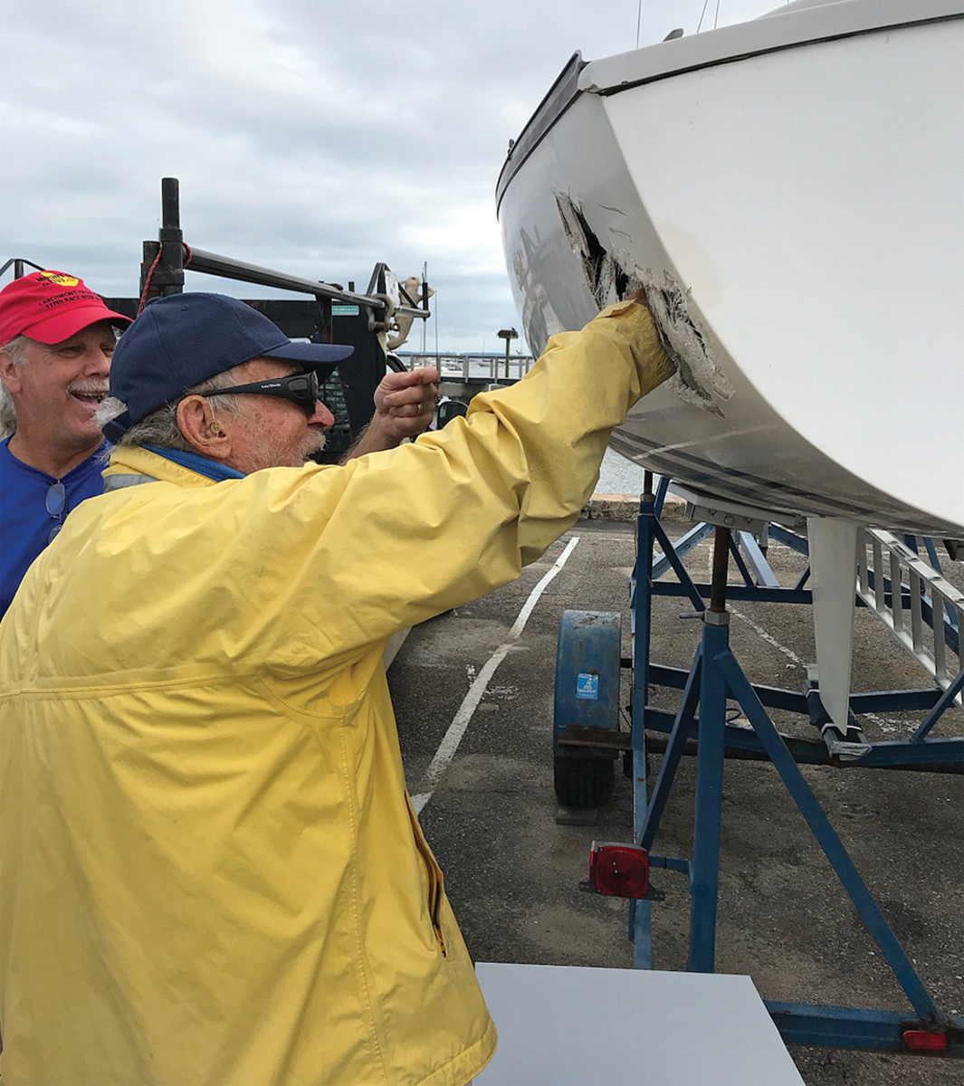 Sonar creator Bruce Kirby checks out a boat that got a bit too close to the competition