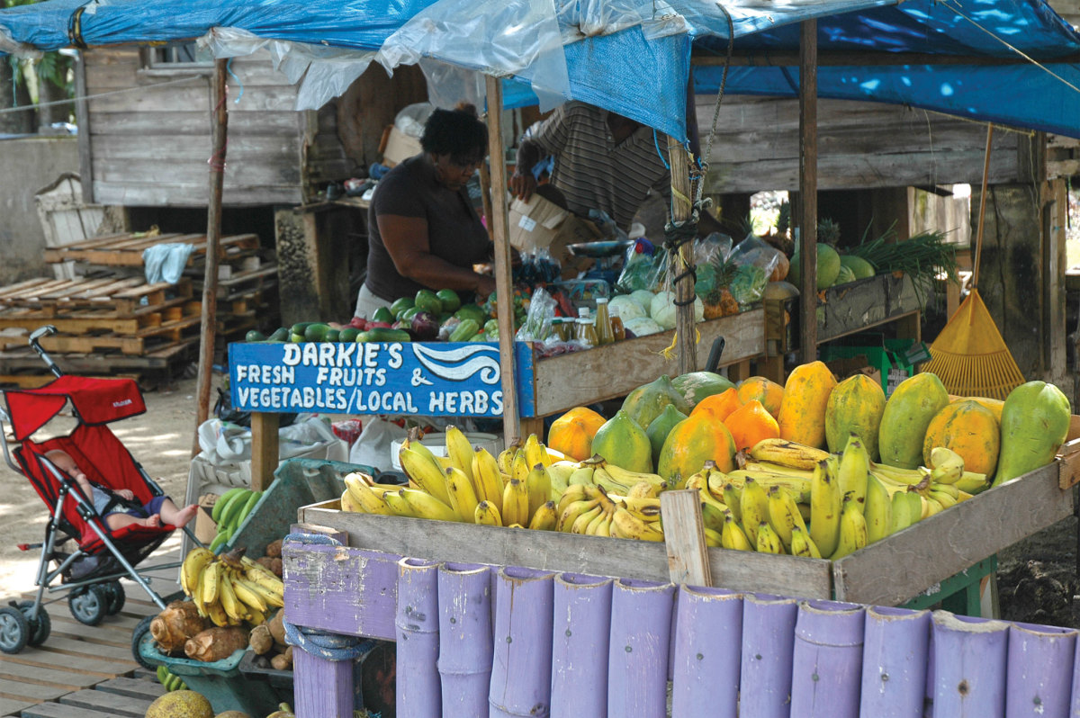 Street vendors offer a variety of fruits and vegetables
