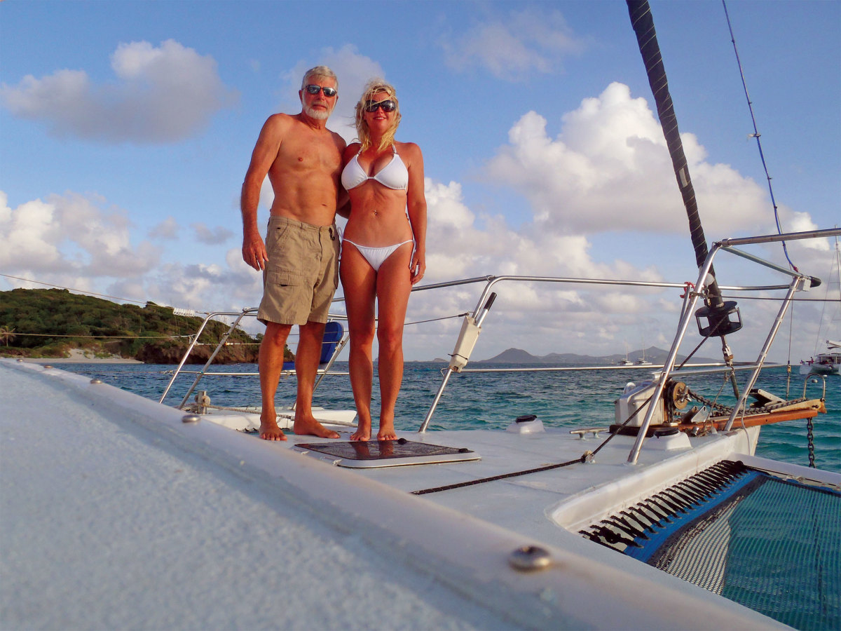 Bill and JoAnne on the bow of their trimaran, ULTRA