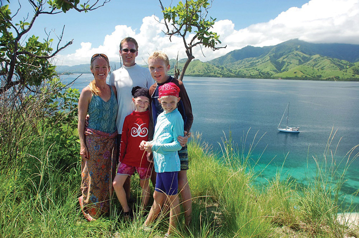 The Gifford family (from left) Behan, Jamie, Siobhan, Niall and Mairen) posing by the Andaman Sea, with their sailboat Totem, in the background, 2014