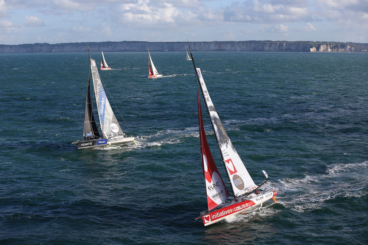 Part of the IMOCA Open 60 fleet heads offshore bound for Brazil shortly after the start of the Transat Jacques Vabre