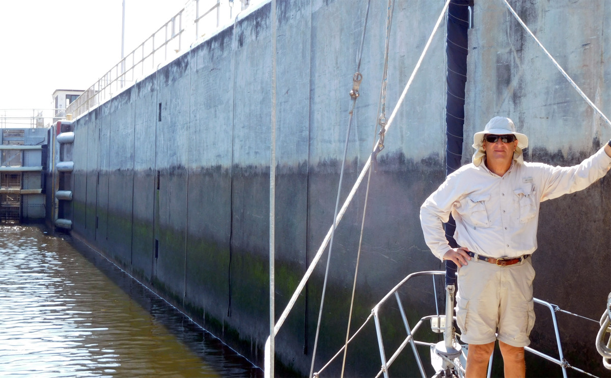 The author's co-captain tends lines at one of the waterway's multiple locks