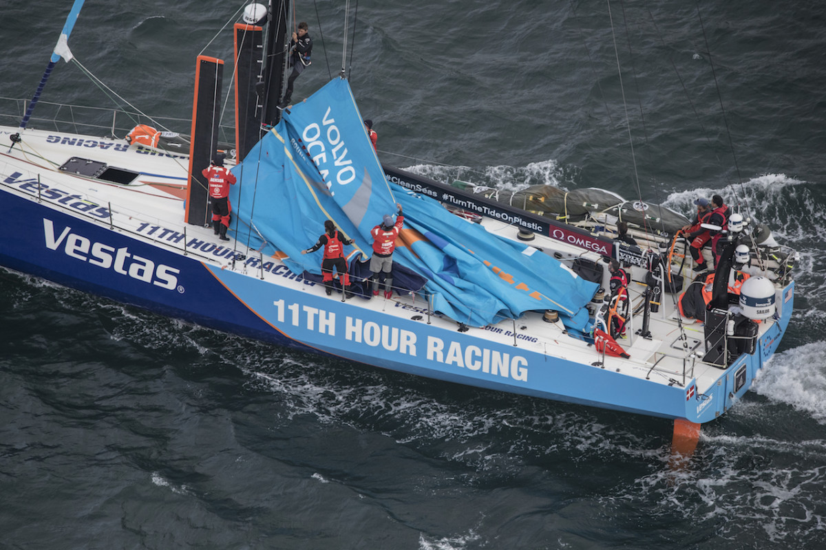 Vestas 11th Hour Racing limps into the harbor at Hong Kong under its own power after the collision
