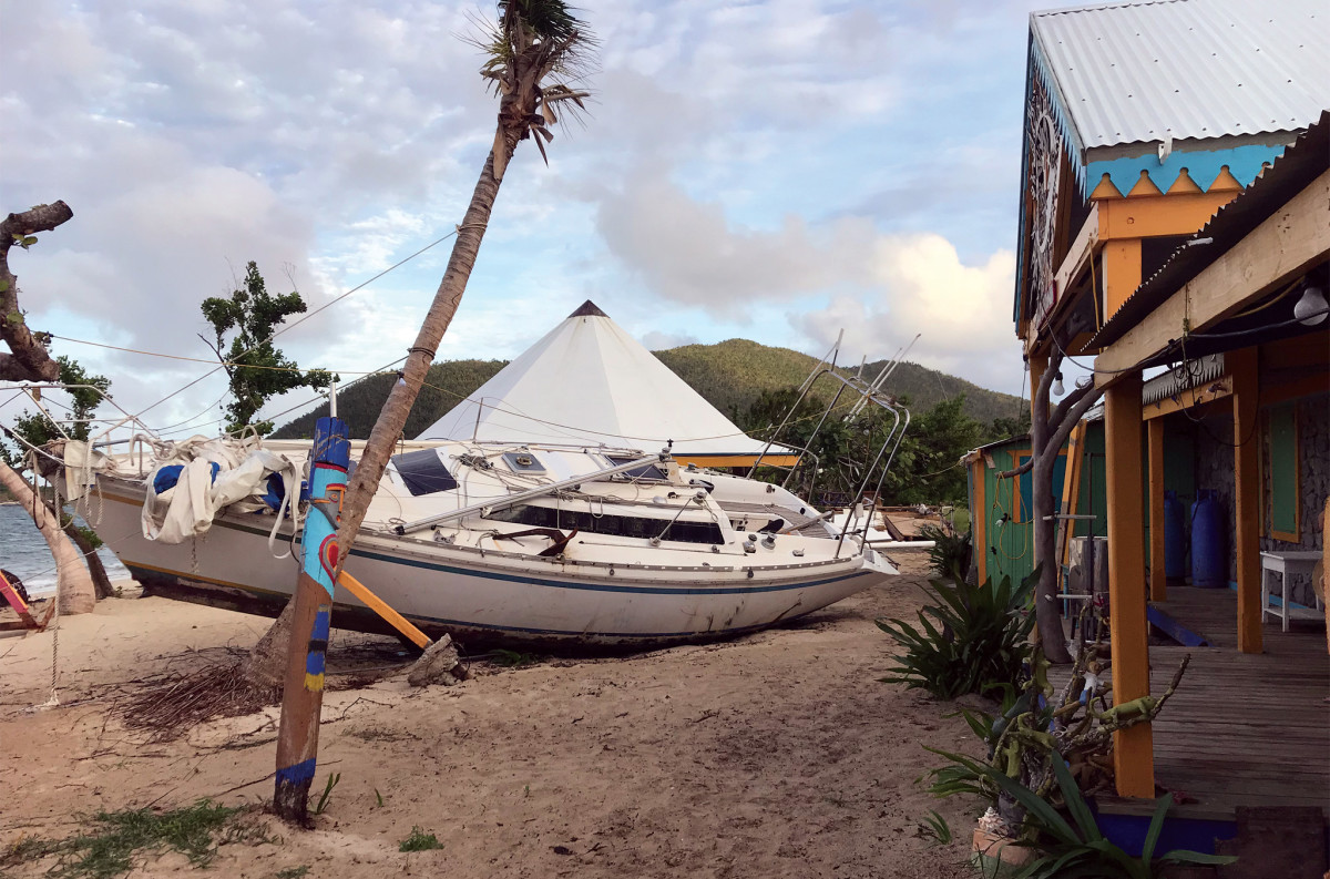 One of many beached boats in Trellis Bay lies outside Aragorn's Studio