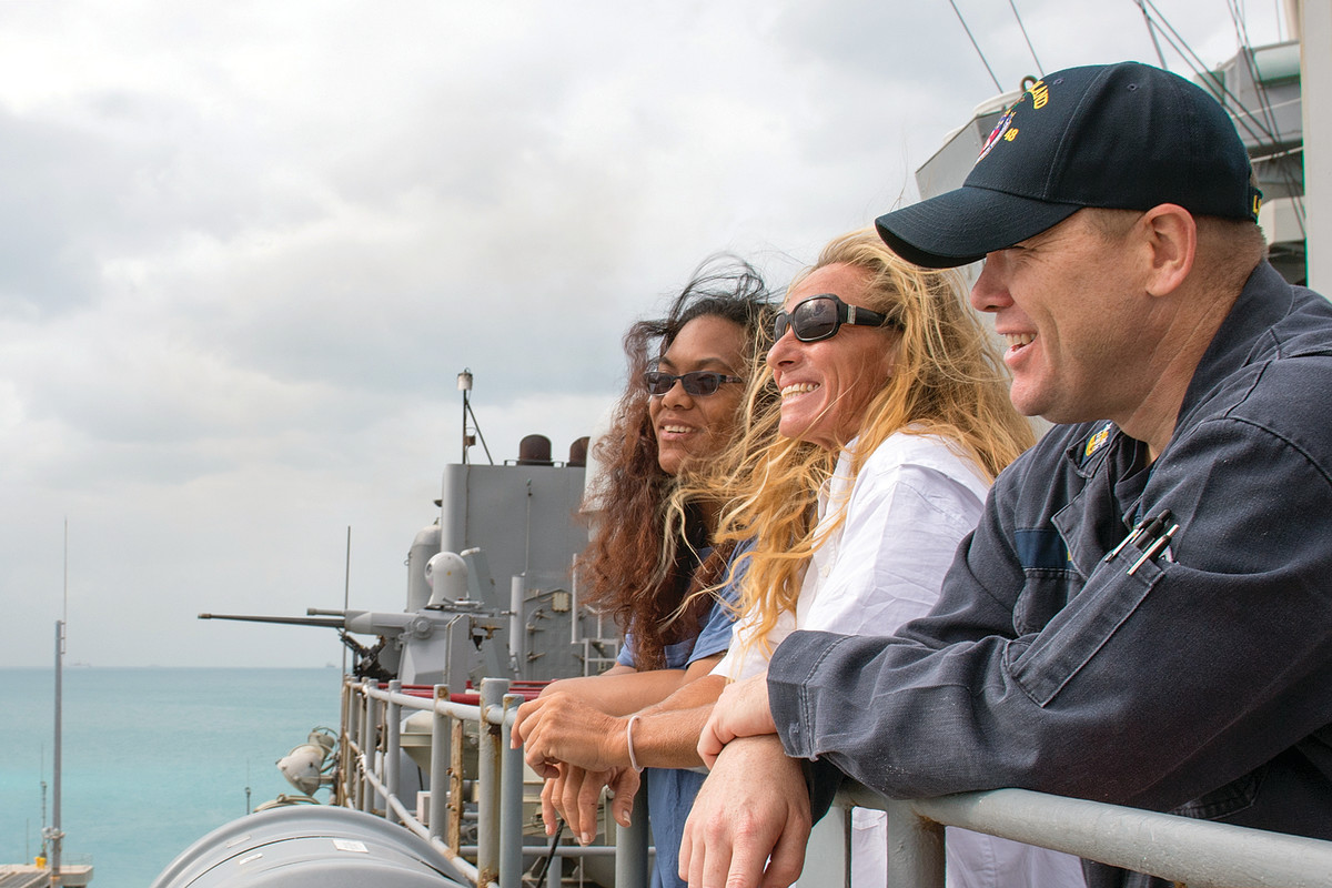 A Navy tender nears Sea Nymph
