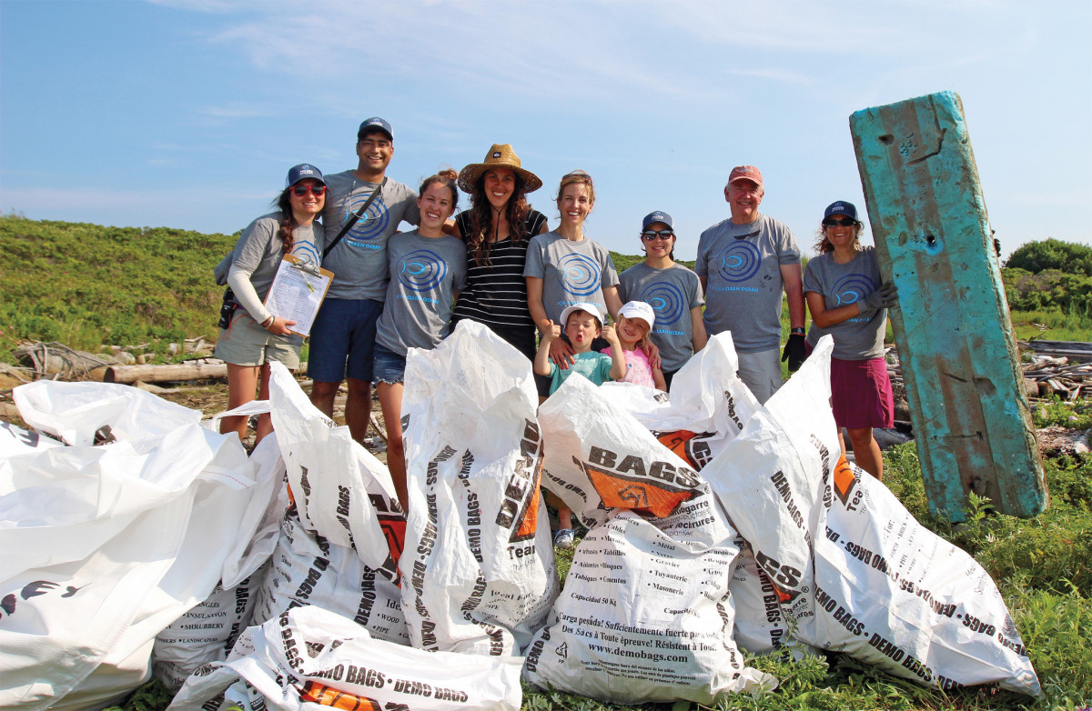 The Rozalia Project crew shows off the results of a clean up on Damariscove Island