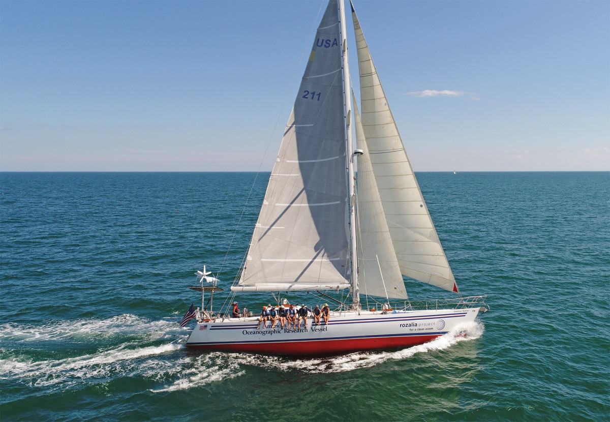 American Promise reaches across Massachusetts Bay with her solar panels, wind turbines and hydro generator all working hard
