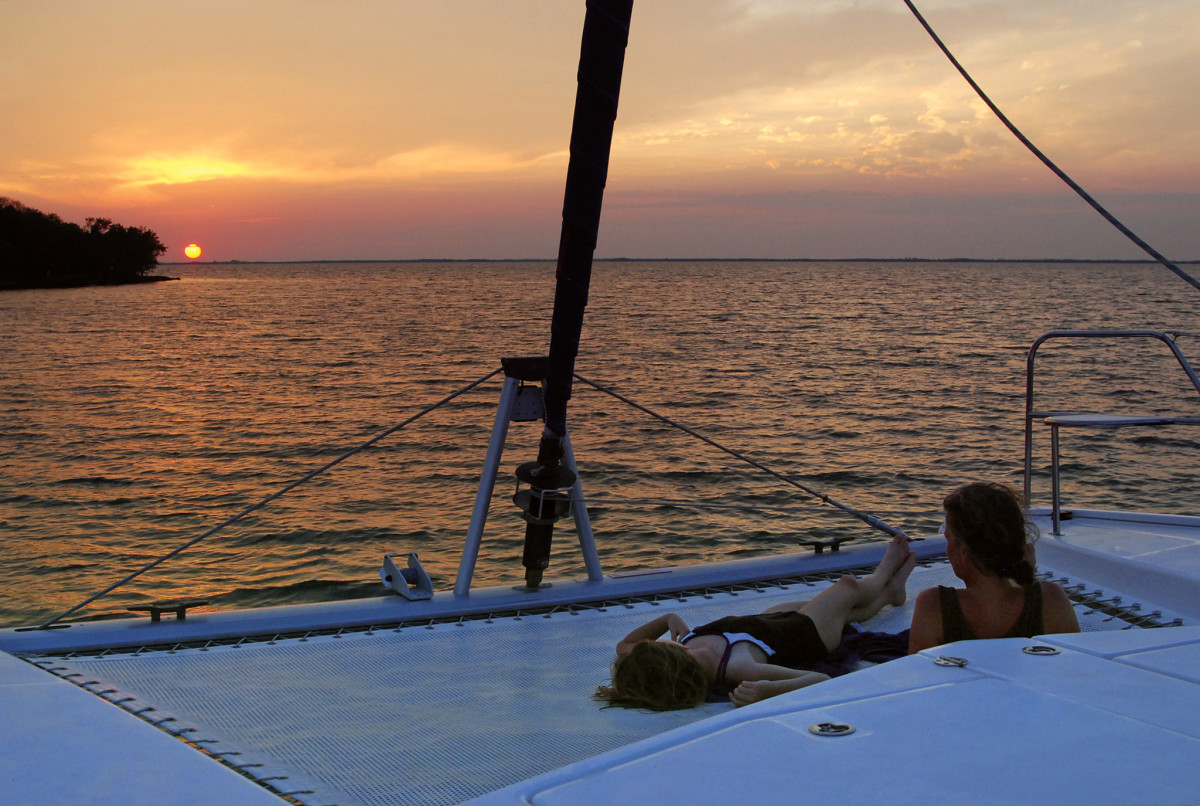 A couple enjoys the sunset in the Florida Keys within spittin' distance of Miami