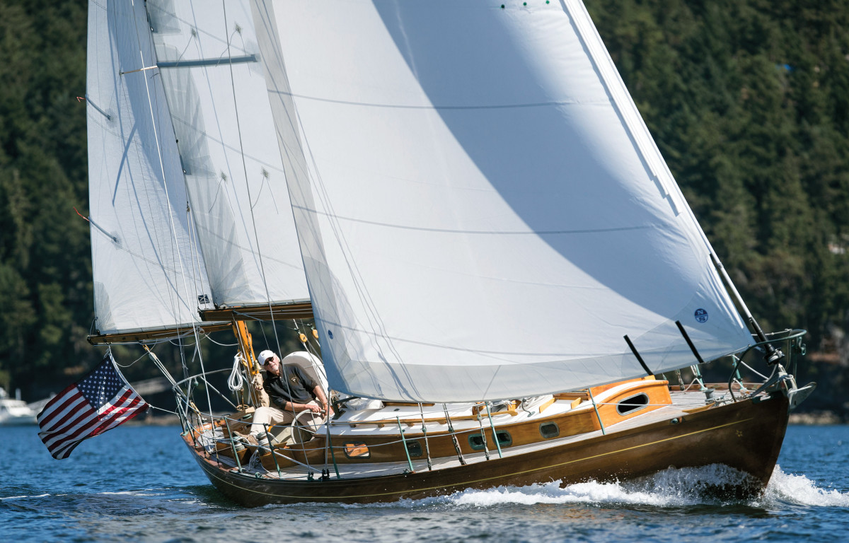 The fully restored Coriolis sails hard on the wind with her owner at the helm