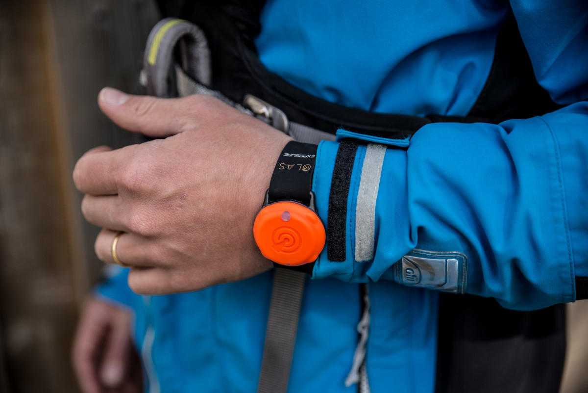 The OLAS crew-overboard alarm app fob is worn on the wrist