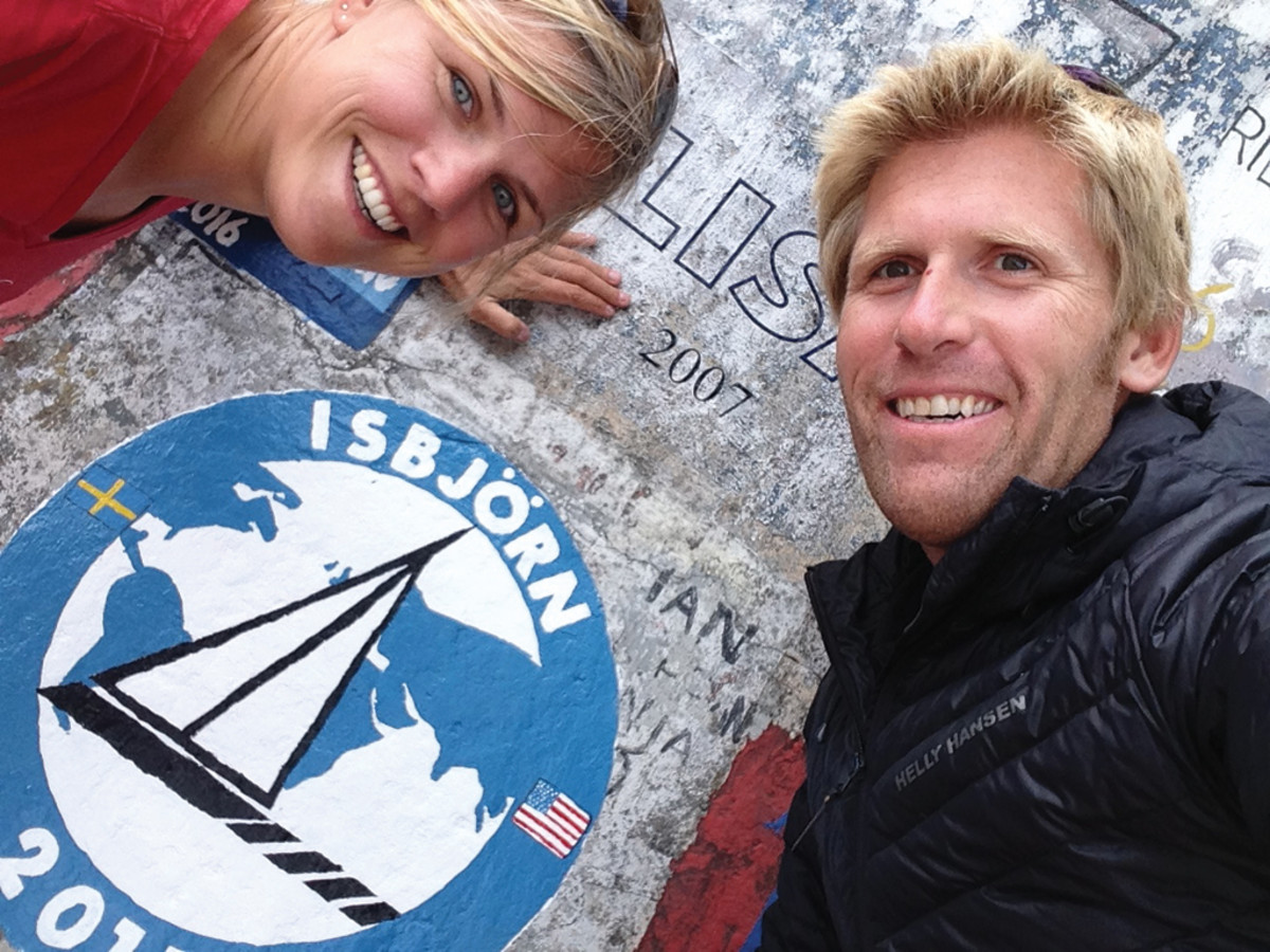 Mia and Andy add Isbjörn's name to the wall at Horta's marina