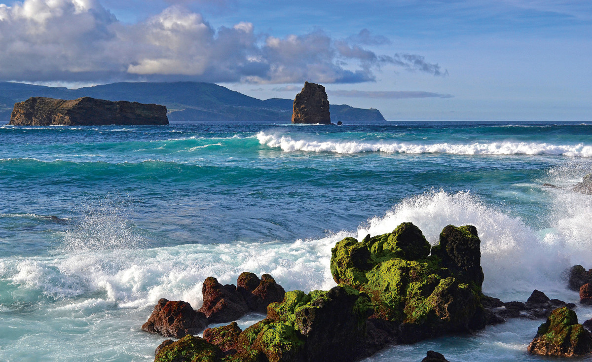 Waves break on the rugged coast of Faial, one of the Azores islands