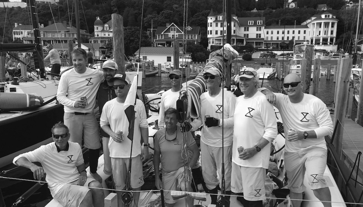"The Boys in the Boat: The Meridian X crew after the CYC Race to Mackinac in 2018, the year after Wheeler's man-overboard incident. L-R: Sledd Shelhorse (owner), Max Plarr, Patrick Everhart, Graham Garrenton, David Flynn, Harold ""Beau"" Warren, Ron McLean, Mark Wheeler, Jeremiah Dull. Courtesy photo."