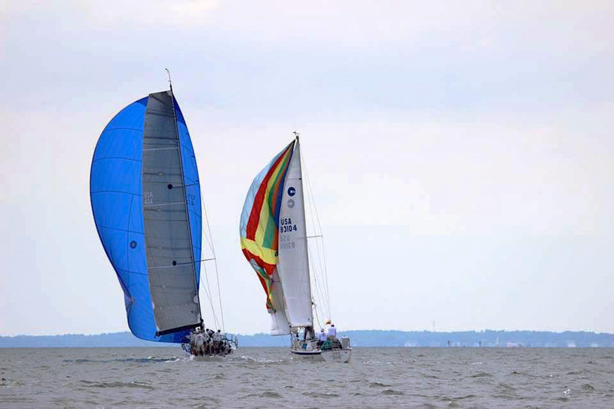 Meridian X (left) flying her A2 spinnaker in a moderate breeze. Courtesy photo.