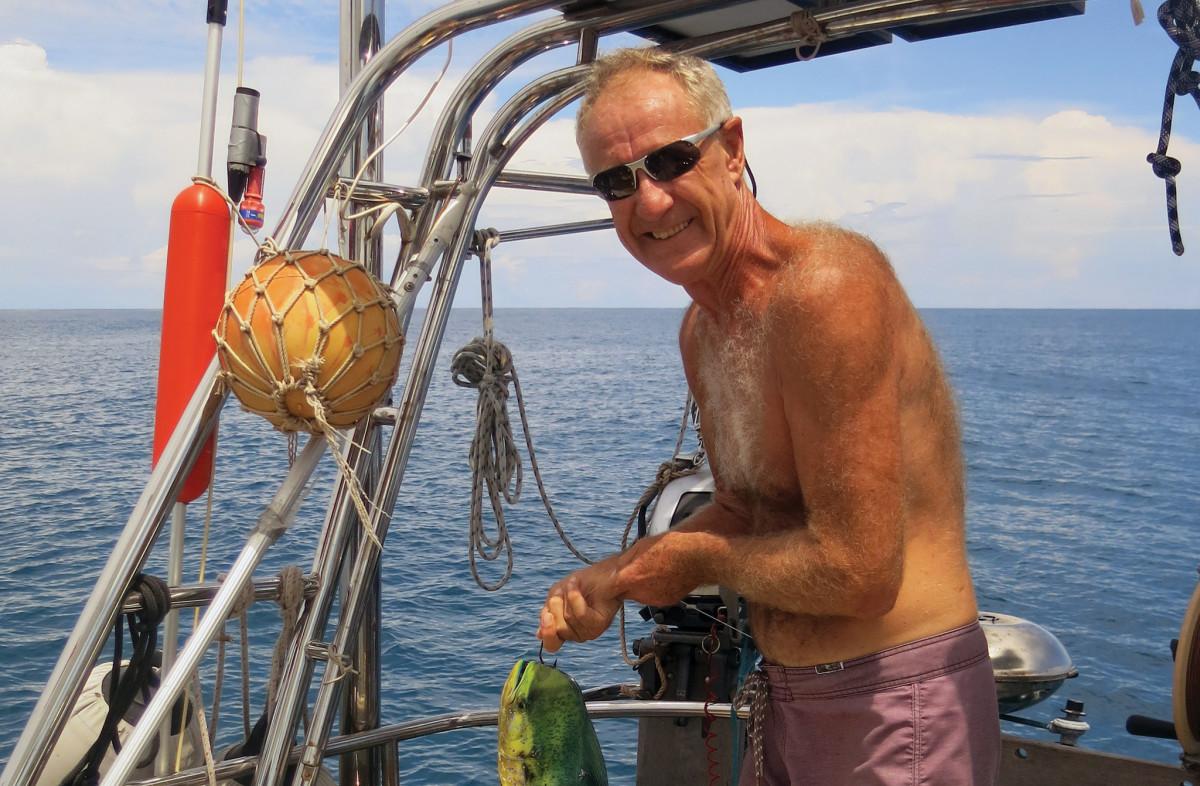 Neil holds a freshly-caught dorado