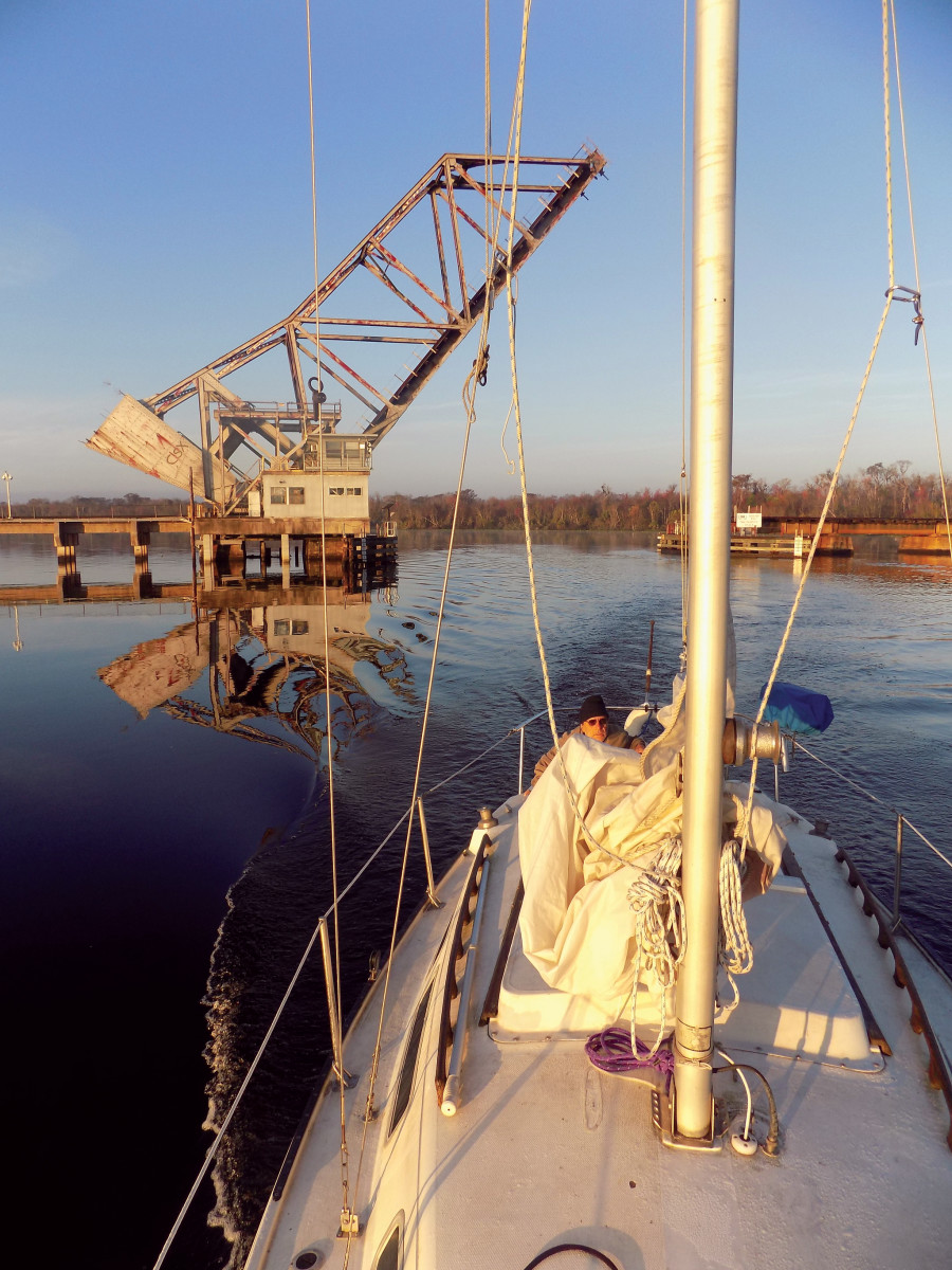 Richie pilots First Draft past the final railroad bridge
