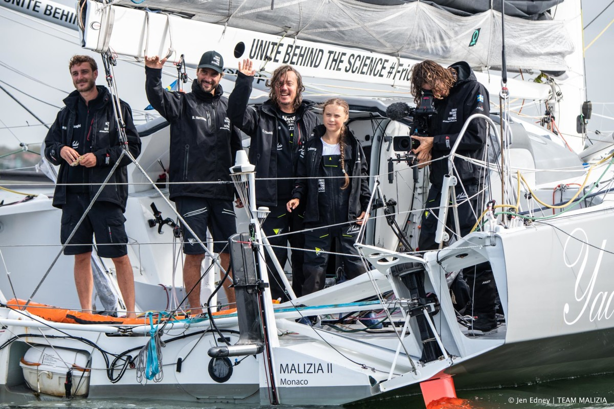 The crew celebrates its safe arrival in the Big Apple after two weeks at sea