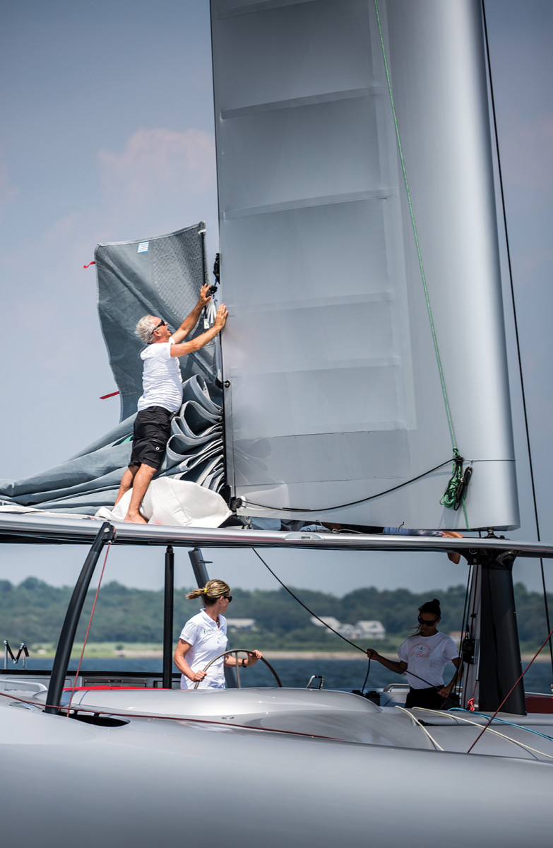 The two elements of the hybrid wing sail are connected by boat captain Tommy Gonzalez