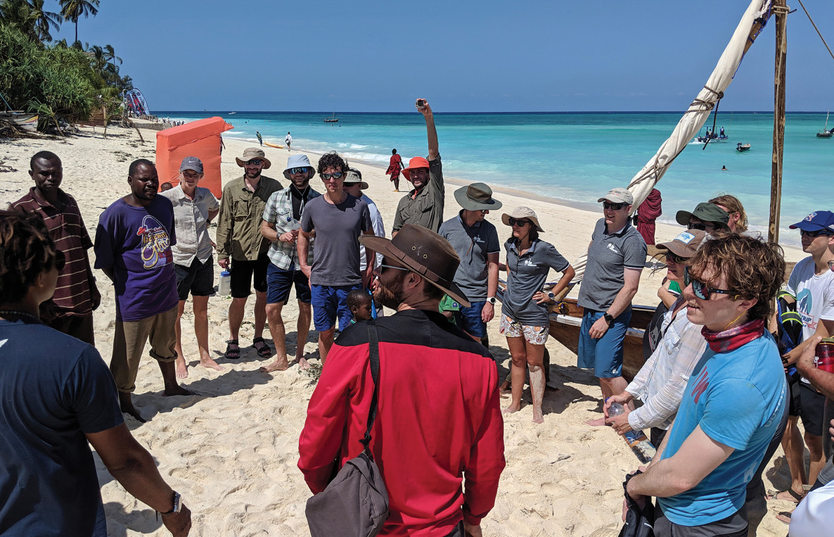 Teams gather for the first time on a beach in Nungwi, Zanzibar, to see the race boats and get to know their fellow competitors