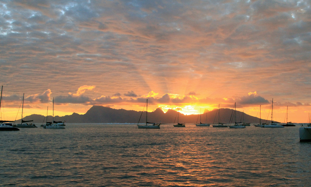 From our anchorage on Tahiti, we watch another spectacular sunset over Moorea