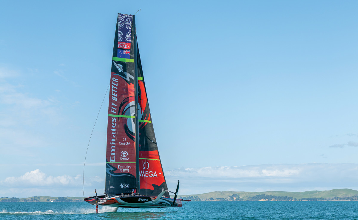 Te Aihe flies across the waters of Auckland harbor where the 36th America's Cup will take place
