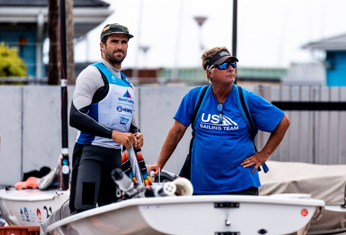Laser sailor Charlie Buckingham (left) and coach Luther Carpenter check out the competition